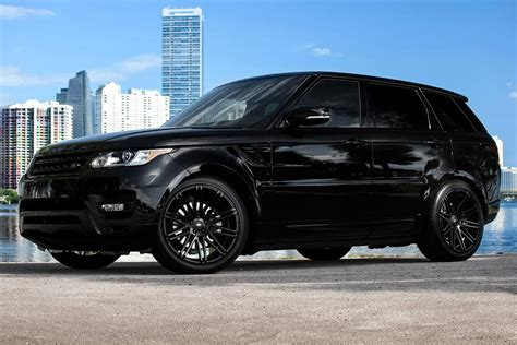 black land rover with black xo 174 milan wheels matte black rims
