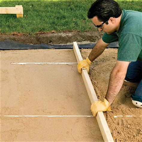 Leveling Patio Base by Screeding Sand Gallery