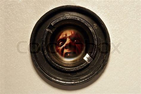 Apartment Door Peephole Looking Through The Peephole Of An Apartment Door At An