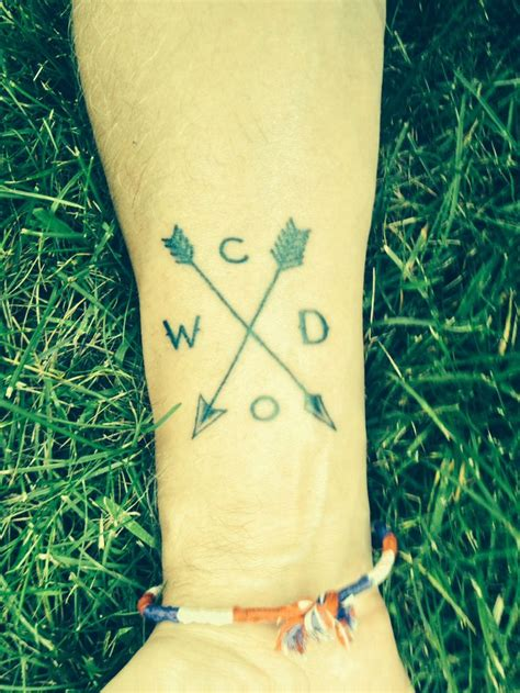 tattoo 4 family initials arrows represent crossed paths