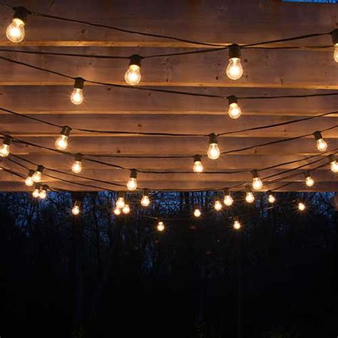Outdoor String Patio Lighting How To Plan And Hang Patio Lights Patio Lighting Pergolas And Patios