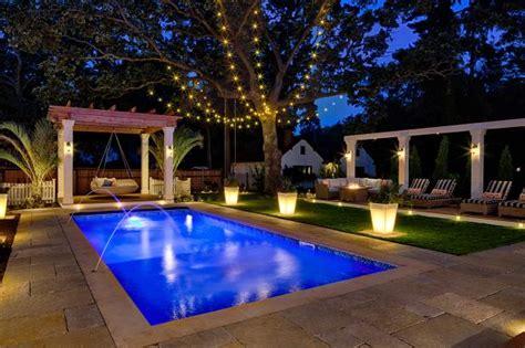 peek into this resort style backyard hgtv s decorating