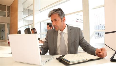office worker in front of desktop computer stock footage