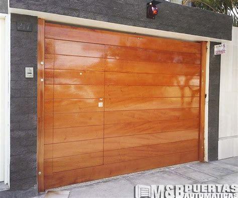 puertas de garaje puertas de garaje en madera cedro m b puertas autom 225 ticas