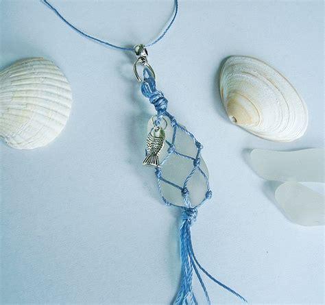 Macrame Net - sea glass in macrame fishing net with a silver fish sea