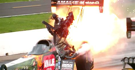 a top fuel dragster s engine up in motion