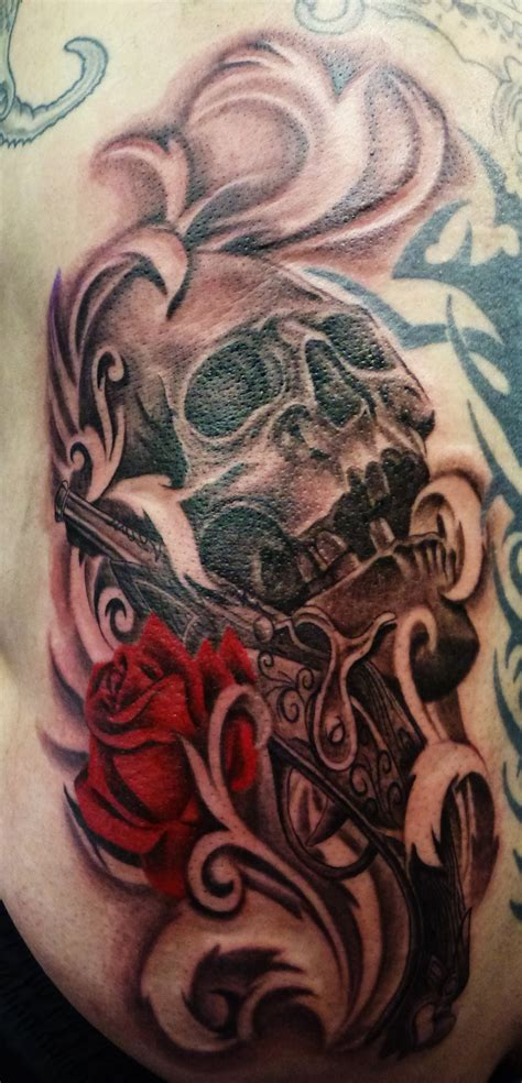 red skull tattoo and skull on hip