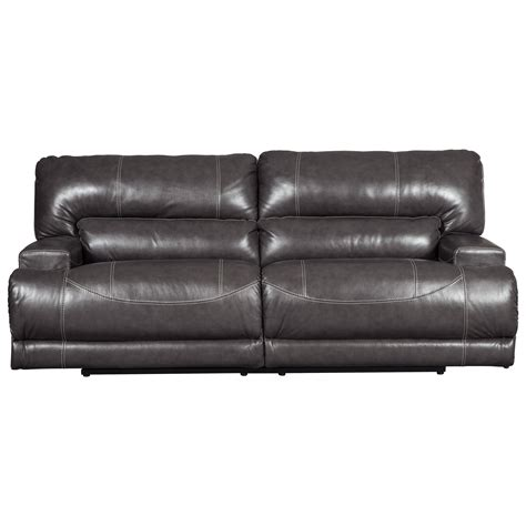 signature leather reclining sofa signature design by mccaskill u6090047 contemporary