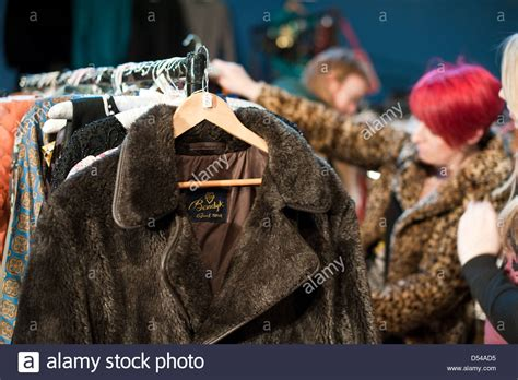 vintage clothes fair with student looking at a