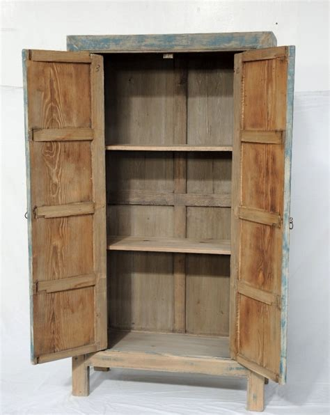 book of woodworking plans for tall cabinet in germany by reclaimed wood tall cabinet with blue details