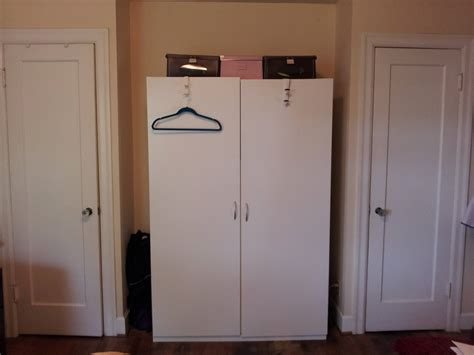 half closet half desk how to organize a lot of clothing in very little closet space