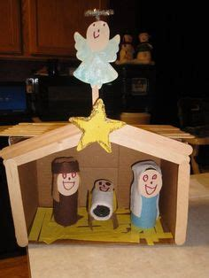 homemade nativity from clay and popsicle sticks. credit