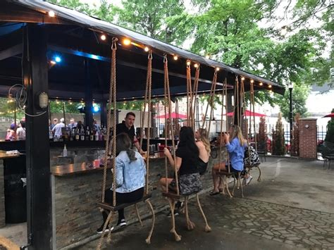 the swing bar no secret knock required treehouse patio bar offers swing