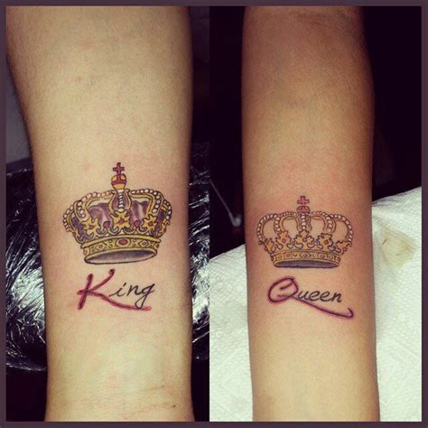his and her king and queen crown tattoos on inner arms