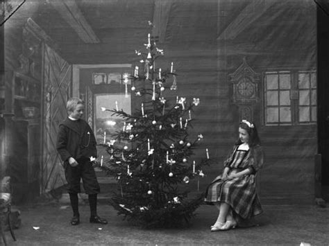 christmas decorations in the 1800s nordic with candles and candle holders on the tree a studio photograph from the