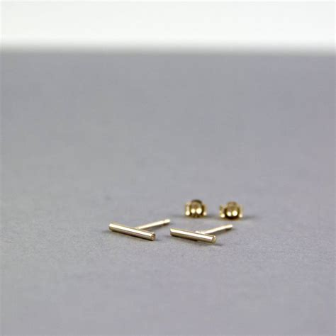 contemporary thin line bar stud earrings by gaamaa