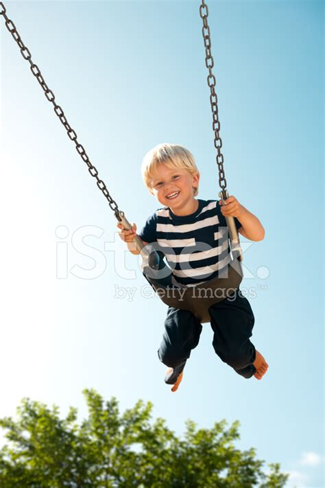 kid swing kid swinging stock photos freeimages