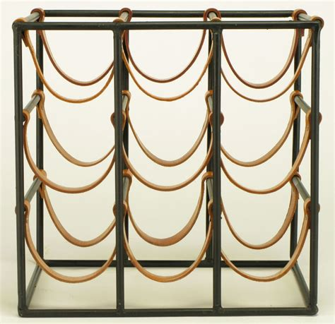 Black Wrought Iron Wine Rack by Arthur Umanoff Black Wrought Iron And Leather Wine Rack At