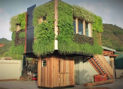 live house elevated grid tiny house with live plant siding