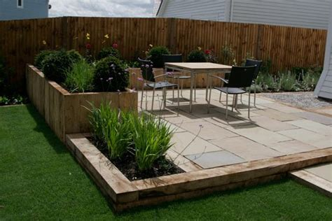 Oak sleepers, Sandstone paving and Raised beds on Pinterest