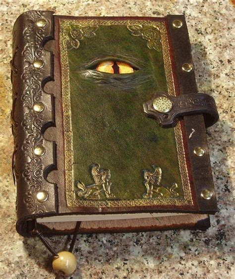 Handmade Leather Notebooks - handmade tooled leather journal with a reptilian