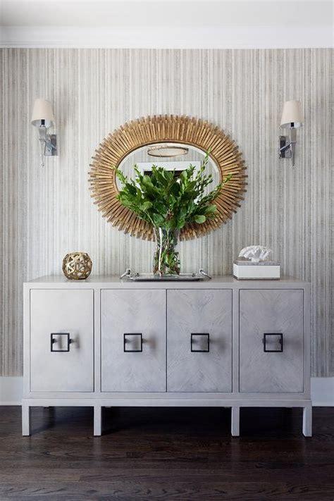 Gold Oval Mirror Over GRay Credenza Cabinet Contemporary Entrance/foyer