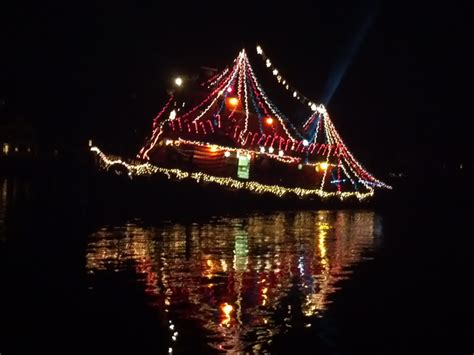river street boat parade santa arrives by tugboat and tree lighting in mystic ct