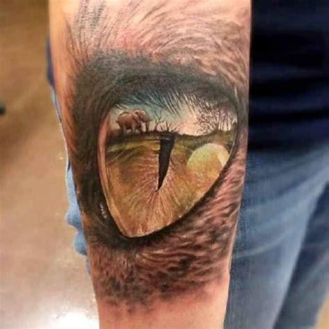 Elephant Eye Tattoo | incredible 3d elephant view in reptile eye tattoo on arm