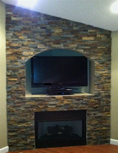 Stone Wall Tiles For Living Room by Stacked Stone Wall With Arch Traditional Living Room