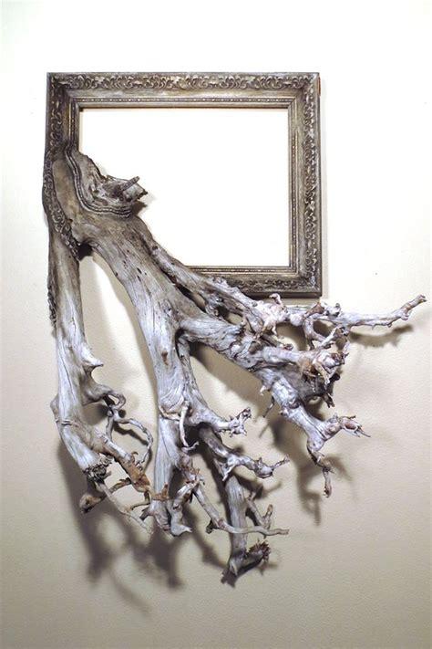 l arte nell abbraccio tra una cornice e un tronco d albero