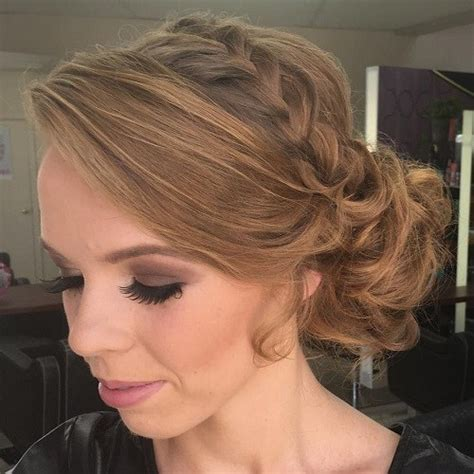 wedding hairstyles that are right on trend prom hairstyles side bun with braid www pixshark
