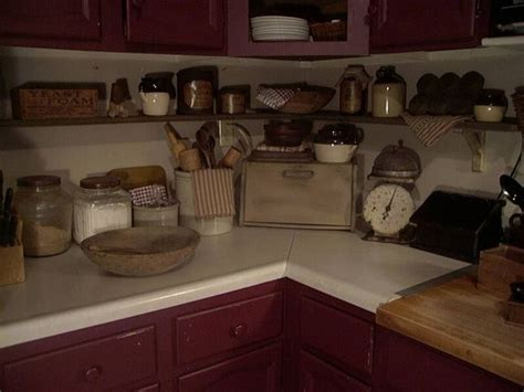 primitive decorating ideas for kitchen i all the antiques on this counter and shelf but i wouldn t anywhere to work hmmmm