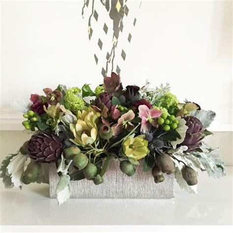 composizione floreale fiori finti oltre 25 fantastiche idee su fiori natalizi su