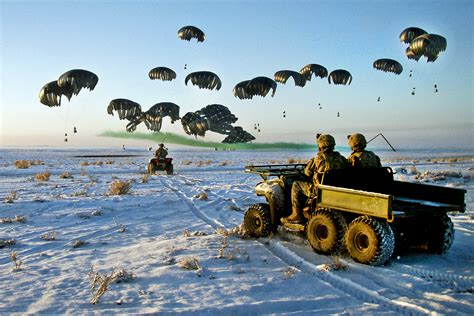 military air vehicles u s army soldiers in four wheel drive vehicles wait as