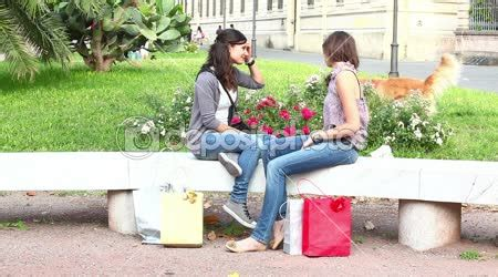 park bench group counseling two women of group therapy talking wideo stockowe