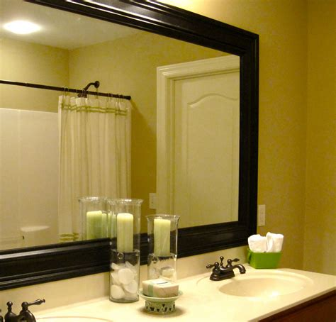 Framing Out A Bathroom Mirror by Remodelaholic Bathroom Mirror Frame Tutorial
