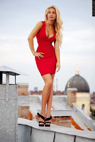 blonde bob red dress blonde with a long thin curls in red short dress and high