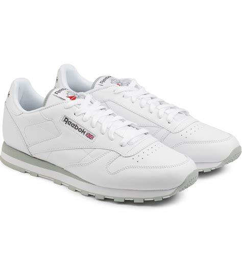 white low top sneakers reebok white cl leather low top sneakers in white for