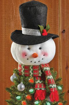 how to make a snowman tree hugger sisal snowman tree topper http shop crackerbarrel sisal snowman tree topper dp b00ngyrgig