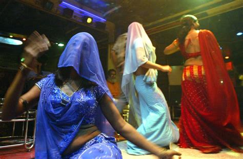 indian bar girls perform at a dance bar in mumbai
