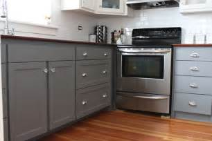 Gorgeous two tone kitchen features lower cabinets painted gray