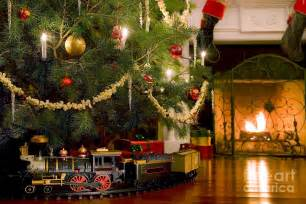 toy train under the christmas tree photograph by diane