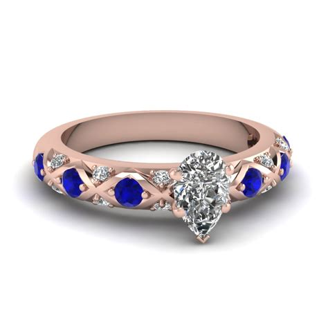 pear shaped cross band side engagement ring