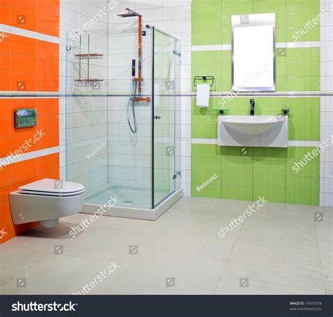green and orange bathroom contemporary bathroom green orange ceramics stock photo
