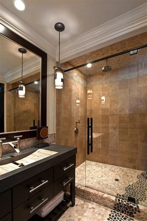 large tan black pebble tile shower  bathroom flooring