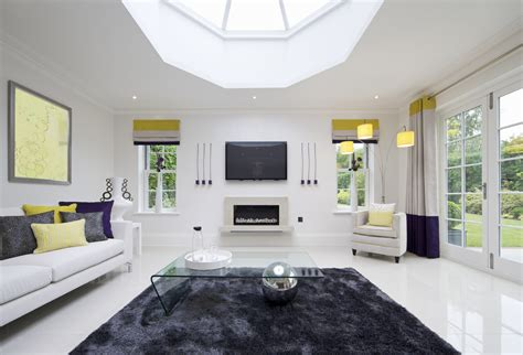 Brilliant white living room sparked by splashes of color shades of