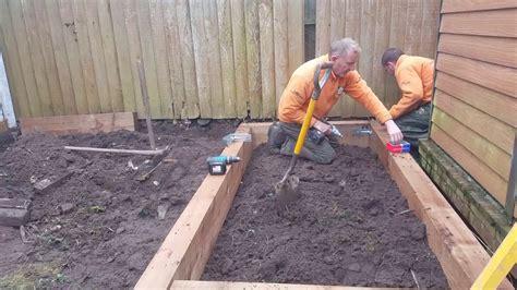 build raised beds  railway sleepers youtube