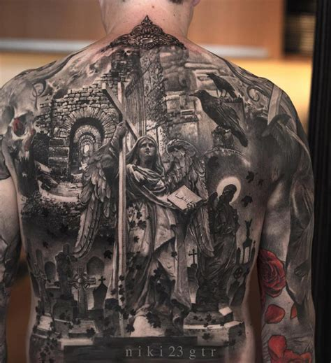 religious piece on guys back best tattoo design ideas