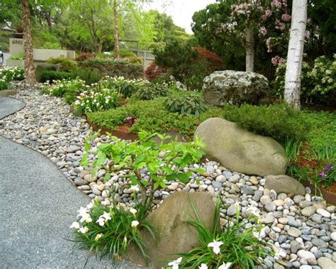 river rock flower bed river rock in flower beds work in progress pinterest