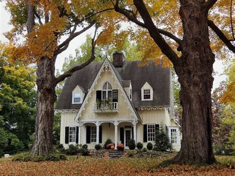 pittsford backyard cottage darling little storybook house with pumpkins on porch